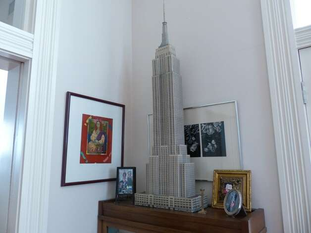 A paper Empire State Building adorns a parlor in the Pancoast home south of downtown San Antonio on Wednesday, Jan. 30, 2013. Photo: Billy Calzada, San Antonio Express-News / SAN ANTONIO EXPRESS-NEWS