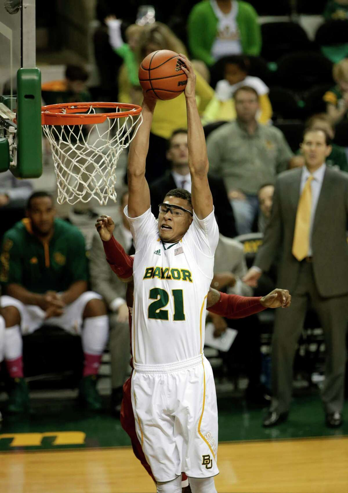3368 x 4768~~$~~Baylor center Isaiah Austin (21) comes down with a rebound in front of an Oklahoma defender in the first half of an NCAA college basketball game Wednesday, Jan. 30, 2013, in Waco, Texas. Austin had 17-rebounds in the 74-71 Oklahoma win.