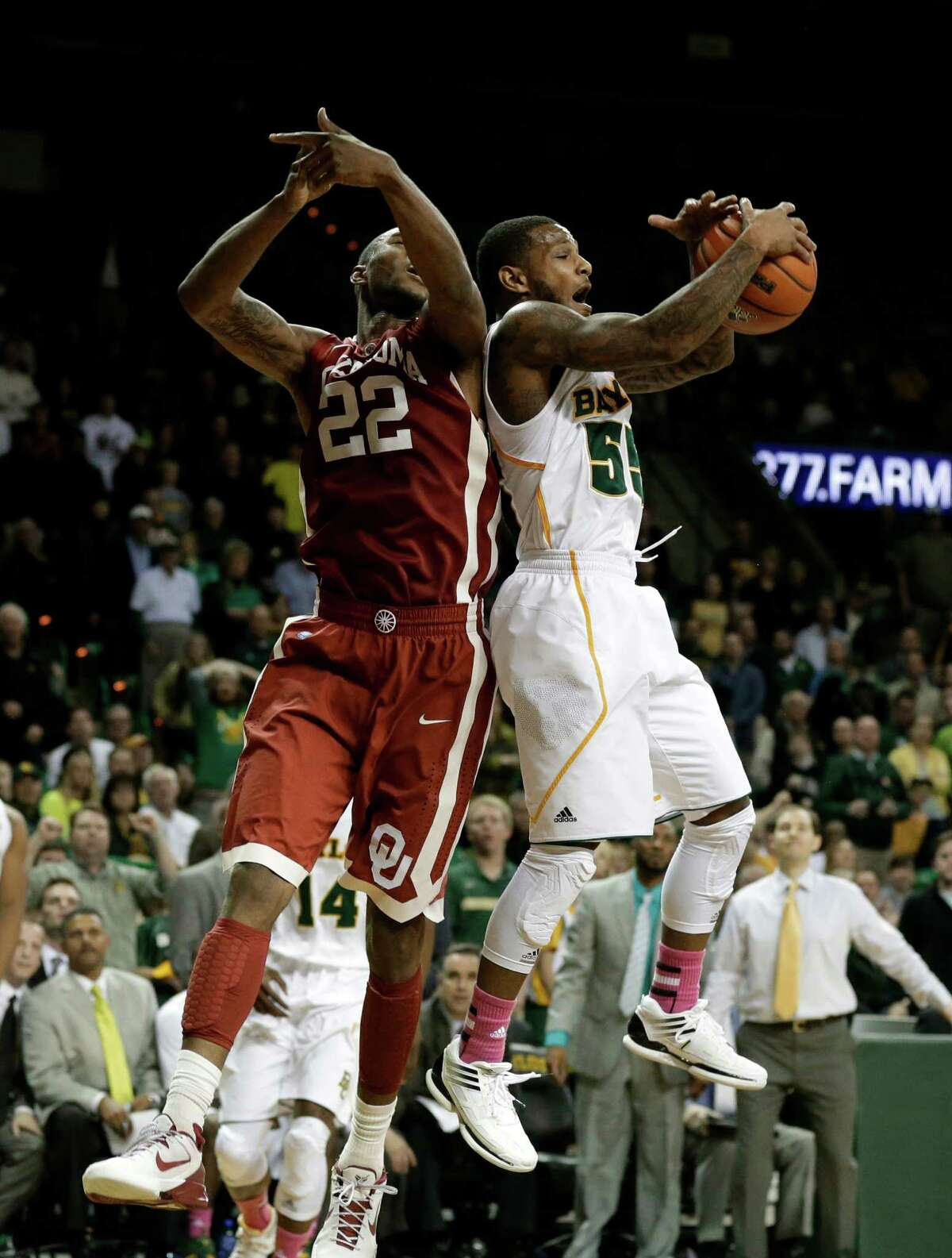 Baylor 's Pierre Jackson, right, comes down with a rebound in front of Oklahoma 's Amath M'Baye (22) late in the second half of an NCAA college basketball game Wednesday, Jan. 30, 2013, in Waco, Texas. Jackson lead all scoring with 22-points in the 74-71 loss to Oklahoma. (AP Photo/Tony Gutierrez)