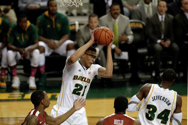 Baylor 's Isaiah Austin (21) comes down with a rebound over Oklahoma 's Je'lon Hornbeak, bottom left, and Buddy Hield, center bottom, in the first half of an NCAA college basketball game Wednesday, Jan. 30, 2013, in Waco, Texas. Oklahoma won 74-71. (AP Photo/Tony Gutierrez) Photo: Tony Gutierrez, Associated Press / AP