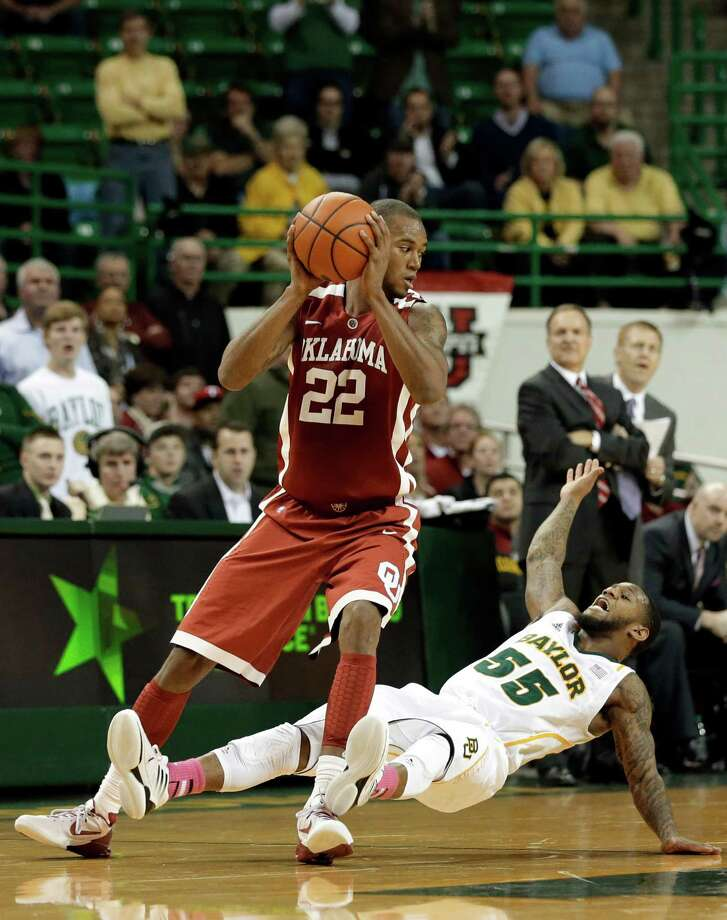 Oklahoma 's Amath M'Baye (22) looks over his shoulder after being fouled by Baylor 's Pierre Jackson (55) late in the second half of an NCAA college basketball game Wednesday, Jan. 30, 2013, in Waco, Texas. Oklahoma won 74-71. (AP Photo/Tony Gutierrez) Photo: Tony Gutierrez, Associated Press / AP