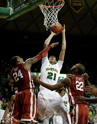 Baylor 's Isaiah Austin (21) goes up for a shot as Oklahoma 's Romero Osby (24) and Amath M'Baye (22) defend in the second half of an NCAA college basketball game Wednesday, Jan. 30, 2013, in Waco, Texas. Oklahoma won 74-71. (AP Photo/Tony Gutierrez) Photo: Tony Gutierrez, Associated Press / AP