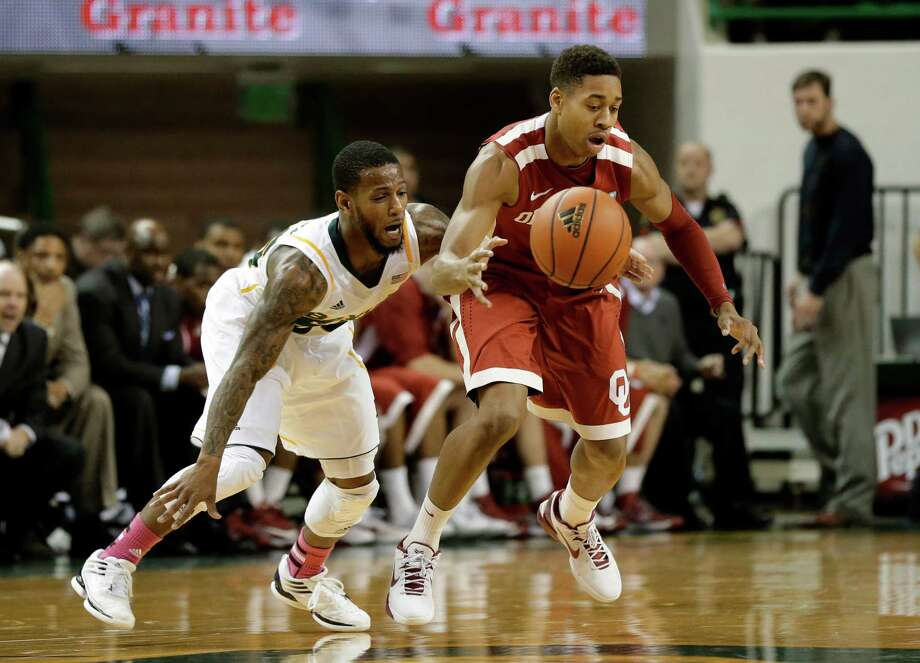 Baylor 's Pierre Jackson (55) knocks the ball away from Oklahoma 's Isaiah Cousins (11) in the second half of an NCAA college basketball game Wednesday, Jan. 30, 2013, in Waco, Texas. Oklahoma won 74-71. (AP Photo/Tony Gutierrez) Photo: Tony Gutierrez, Associated Press / AP