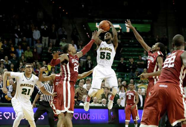 Baylor 's Pierre Jackson (55) attempts a three-point basket in the final seconds of the second half of an NCAA college basketball game as Oklahoma' Romero Osby (24) and Buddy Hield (3) defend Wednesday, Jan. 30, 2013, in Waco, Texas. Baylor's Isaiah Austin (21) and Oklahoma's Amath M'Baye (22) watch in the 74-71 Baylor loss. (AP Photo/Tony Gutierrez) Photo: Tony Gutierrez, Associated Press / AP