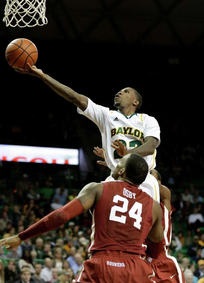 Baylor 's A.J. Walton (22) attempts a shot over Oklahoma 's Romero Osby (24) in the second half of an NCAA college basketball game Wednesday, Jan. 30, 2013, in Waco, Texas. Oklahoma won 74-71. (AP Photo/Tony Gutierrez) Photo: Tony Gutierrez, Associated Press / AP