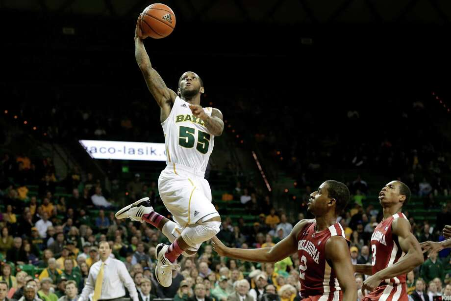 Baylor 's Pierre Jackson (55) goes up for a score over Oklahoma 's Steven Pledger (2) and Buddy Hield, right, in the second half of an NCAA college basketball game Wednesday, Jan. 30, 2013, in Waco, Texas. Jackson had a team high 22-points in the 74-71 Baylor loss. (AP Photo/Tony Gutierrez) Photo: Tony Gutierrez, Associated Press / AP