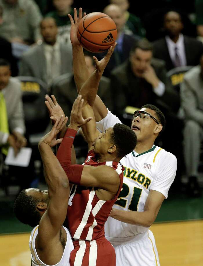 Oklahoma guard Isaiah Cousins (11) has his shot blocked by Baylor center Isaiah Austin (21) with help from Rico Gathers, bottom left, during the first half of an NCAA college basketball game Wednesday, Jan. 30, 2013, in Waco, Texas. (AP Photo/Tony Gutierrez) Photo: Tony Gutierrez, Associated Press / AP