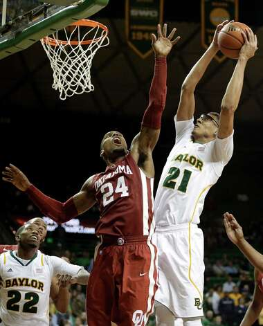 Oklahoma's Romero Osby (24) defends as Baylor's Isaiah Austin (21) goes up for a score in the second half of an NCAA college basketball game as Baylor's A.J. Walton (22) watches Wednesday, Jan. 30, 2013, in Waco, Texas. Oklahoma won 74-71. (AP Photo/Tony Gutierrez) Photo: Tony Gutierrez, Associated Press / AP