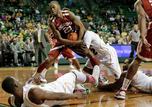 Baylor 's Deuce Bello, bottom left, and Rico Gathers, bottom right, watch as A.J. Walton, center right, struggles with Oklahoma 's Amath M'Baye (22) for control of a rebound during the second half of an NCAA college basketball game Wednesday, Jan. 30, 2013, in Waco, Texas. Oklahoma won 74-71. (AP Photo/Tony Gutierrez) Photo: Tony Gutierrez, Associated Press / AP
