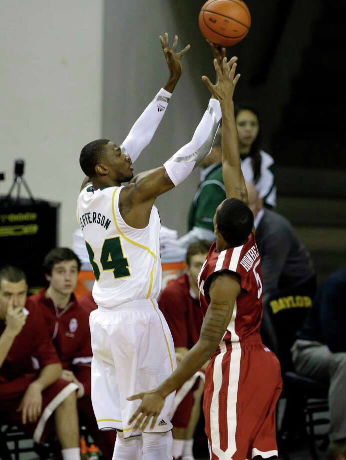Baylor forward Cory Jefferson (34) attempts a shot over Oklahoma 's Je'lon Hornbeak (5) in the first half of an NCAA college basketball game Wednesday, Jan. 30, 2013, in Waco, Texas. (AP Photo/Tony Gutierrez) Photo: Tony Gutierrez, Associated Press / AP