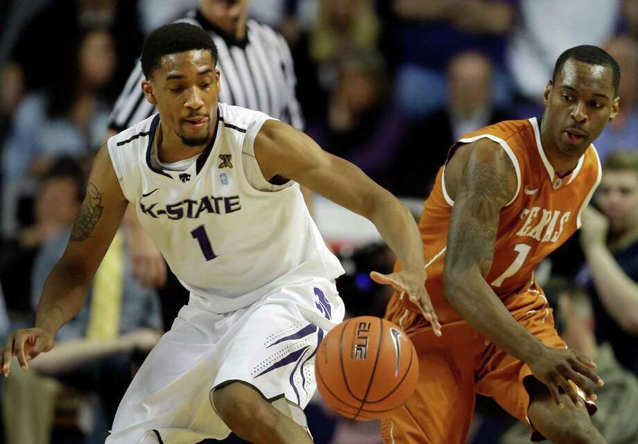 Kansas State guard Shane Southwell (1) reaches for the ball while covered by Texas guard Sheldon McClellan (1) during the first half of an NCAA college basketball game in Manhattan, Kan., Wednesday, Jan. 30, 2013. (AP Photo/Orlin Wagner) Photo: Orlin Wagner, Associated Press / AP