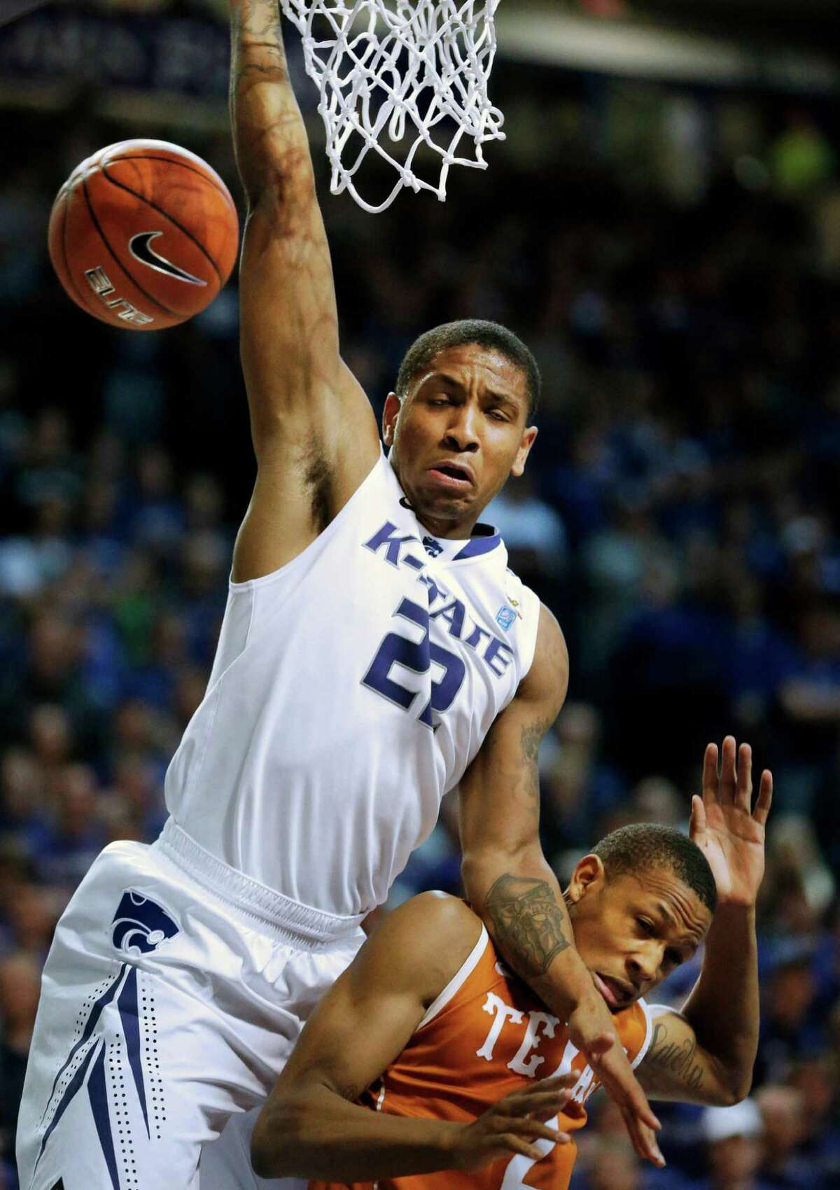 Kansas State guard Rodney McGruder (22) is fouled by Texas guard Demarcus Holland (2) during the second half of an NCAA college basketball game in Manhattan, Kan., Wednesday, Jan. 30, 2013. Kansas State defeated Texas 83-57. (AP Photo/Orlin Wagner)