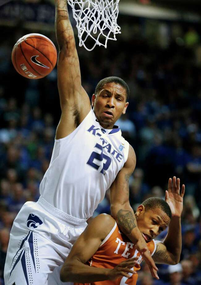 Kansas State guard Rodney McGruder (22) is fouled by Texas guard Demarcus Holland (2) during the second half of an NCAA college basketball game in Manhattan, Kan., Wednesday, Jan. 30, 2013. Kansas State defeated Texas 83-57. (AP Photo/Orlin Wagner) Photo: Orlin Wagner, Associated Press / AP