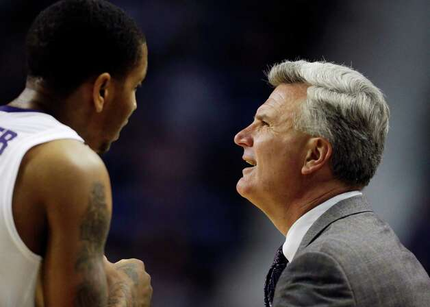 Kansas State head coach Bruce Weber, right, talks with guard Rodney McGruder during the second half of an NCAA college basketball game against Texas in Manhattan, Kan., Wednesday, Jan. 30, 2013. Kansas State defeated Texas 83-57. (AP Photo/Orlin Wagner) Photo: Orlin Wagner, Associated Press / AP