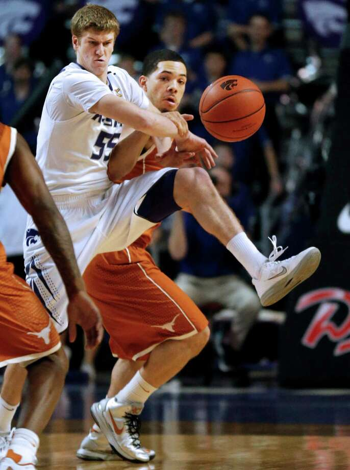 Kansas State guard Will Spradling (55) knocks the ball away from Texas guard Javan Felix (3) during the first half of an NCAA college basketball game in Manhattan, Kan., Wednesday, Jan. 30, 2013. (AP Photo/Orlin Wagner) Photo: Orlin Wagner, Associated Press / AP