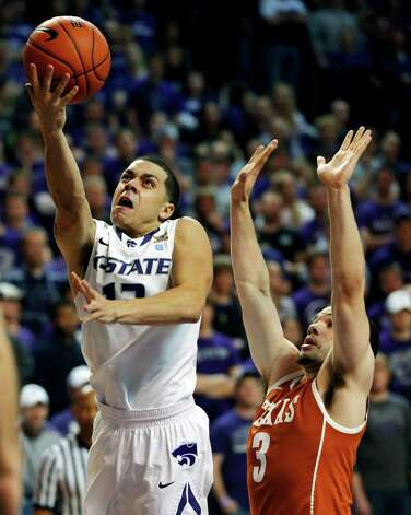 Kansas State guard Angel Rodriguez (13) gets past Texas guard Javan Felix (3) for a basket during the second half of an NCAA college basketball game in Manhattan, Kan., Wednesday, Jan. 30, 2013. Kansas State defeated Texas 83-57. (AP Photo/Orlin Wagner) Photo: Orlin Wagner, Associated Press / AP