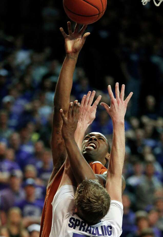 Kansas State guard Will Spradling, front, catches an elbow on the nose by Texas guard Sheldon McClellan (1) during the first half of an NCAA college basketball game in Manhattan, Kan., Wednesday, Jan. 30, 2013. (AP Photo/Orlin Wagner) Photo: Orlin Wagner, Associated Press / AP