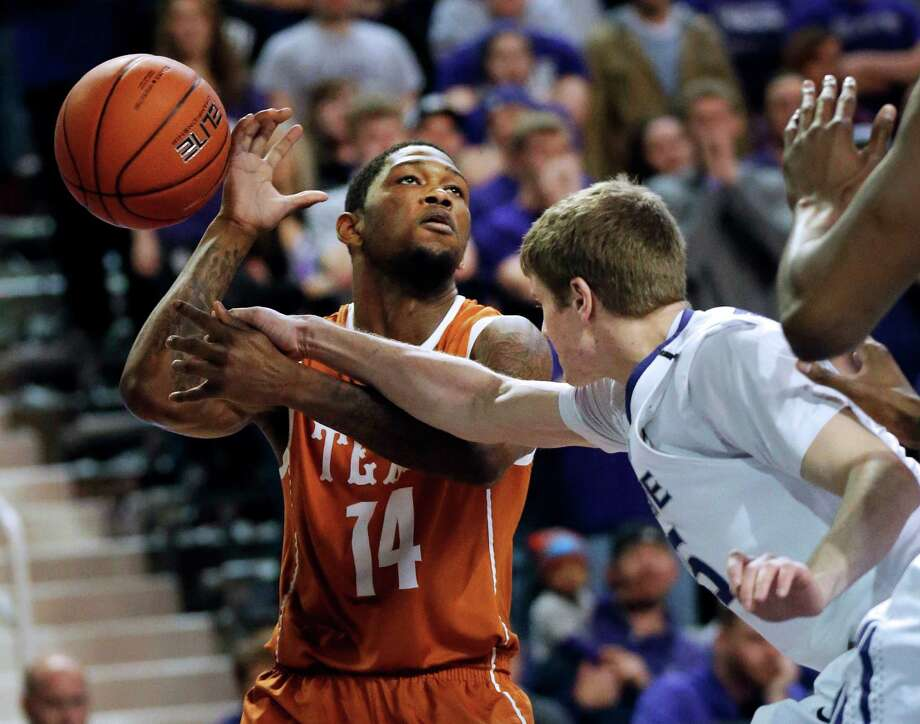 Kansas State guard Will Spradling (55) knocks the ball away from Texas guard Julien Lewis (14) during the first half of an NCAA college basketball game in Manhattan, Kan., Wednesday, Jan. 30, 2013. (AP Photo/Orlin Wagner) Photo: Orlin Wagner, Associated Press / AP