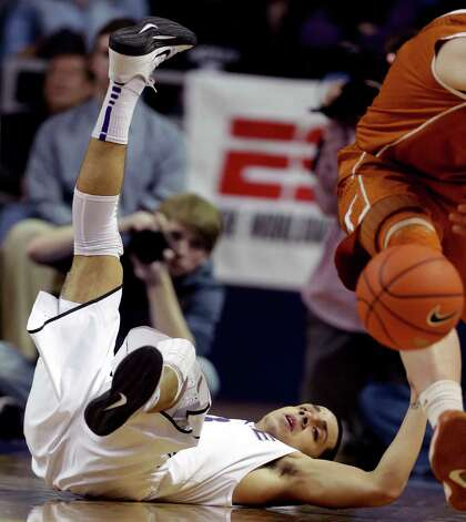 Kansas State guard Angel Rodriguez (13) hits the floor while chasing the ball during the first half of an NCAA college basketball game against the Texas in Manhattan, Kan., Wednesday, Jan. 30, 2013. (AP Photo/Orlin Wagner) Photo: Orlin Wagner, Associated Press / AP