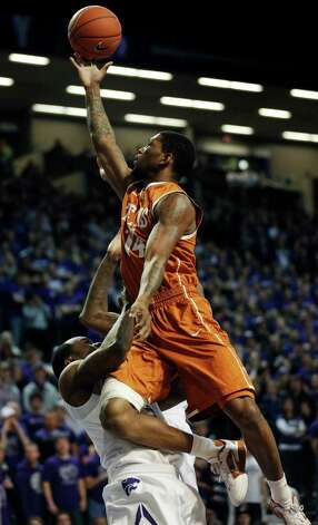 Texas guard Julien Lewis (14) is fouled by Kansas State guard Martavious Irving (3) during the first half of an NCAA college basketball game in Manhattan, Kan., Wednesday, Jan. 30, 2013. (AP Photo/Orlin Wagner) Photo: Orlin Wagner, Associated Press / AP