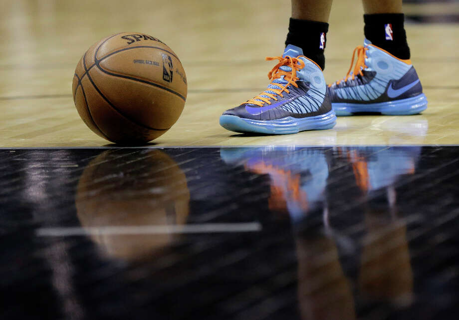 Charlotte Bobcats' Ben Gordon's shoes are reflected as he wait to shoot a free throw during the second half of an NBA basketball game against the San Antonio Spurs, Wednesday, Jan. 30, 2013, in San Antonio. (AP Photo/Eric Gay) Photo: Eric Gay, Associated Press / AP