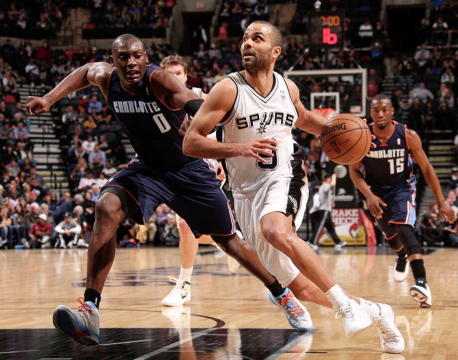 San Antonio Spurs' Tony Parker drives the ball around Charlotte Bobcats' Bismack Biyombo during the first half at the AT&T Center, Wednesday, Jan. 30, 2013. Photo: Jerry Lara, San Antonio Express-News / © 2013 San Antonio Express-News