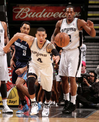 San Antonio Spurs' Danny Green goes for a loose ball against Charlotte Bobcats' Gerald Henderson during the first half at the AT&T Center, Wednesday, Jan. 30, 2013. On the right is Kawhi Leonard. Photo: Jerry Lara, San Antonio Express-News / © 2013 San Antonio Express-News