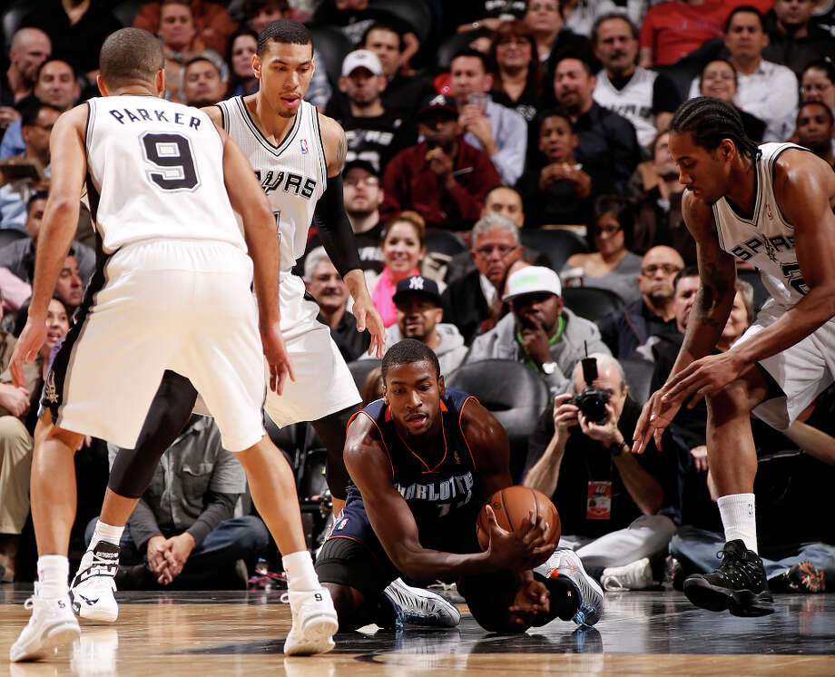 Surrounded by San Antonio Spurs' Tony Parker, from left, Danny Green and Kawhi Leonard, Charlotte Bobcats' Michael Kidd-Gilchrist covers a loose ball during the first half at the AT&T Center, Wednesday, Jan. 30, 2013. Photo: Jerry Lara, San Antonio Express-News / © 2013 San Antonio Express-News