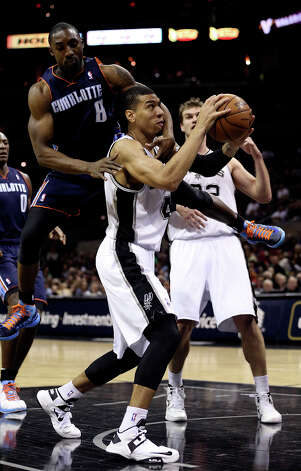 San Antonio Spurs' Danny Green is fouled by Charlotte Bobcats' Ben Gordon during the second half at the AT&T Center, Wednesday, Jan. 30, 2013. The Spurs won 102-78. Photo: Jerry Lara, San Antonio Express-News / © 2013 San Antonio Express-News