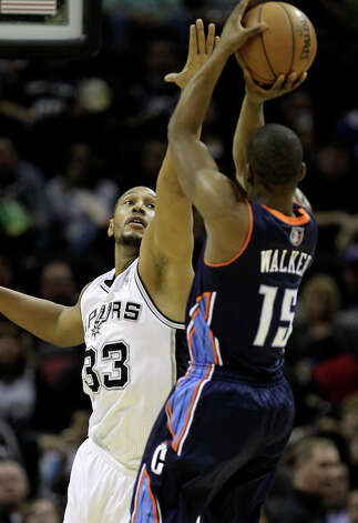 San Antonio Spurs' Boris Diaw reaches in to try and block a shot by Charlotte Bobcats' Kemba Walker during the second half at the AT&T Center, Wednesday, Jan. 30, 2013. The Spurs won 102-78. Photo: Jerry Lara, San Antonio Express-News / © 2013 San Antonio Express-News