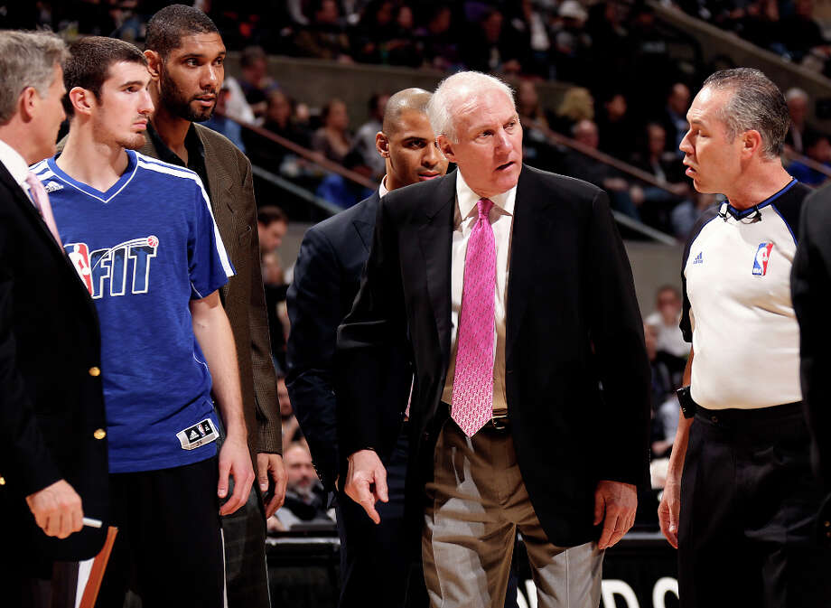 San Antonio Spurs head coach Gregg Popovich exchanges words with official Jason Phillips during the first half at the AT&T Center, Wednesday, Jan. 30, 2013. Photo: Jerry Lara, San Antonio Express-News / © 2013 San Antonio Express-News
