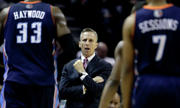 Charlotte Bobcats head coach Mike Dunlap, center, talks to his players during a time out in  the second half of an NBA basketball game against the Charlotte Bobcats, Wednesday, Jan. 30, 2013, in San Antonio. Photo: Eric Gay, Associated Press / AP