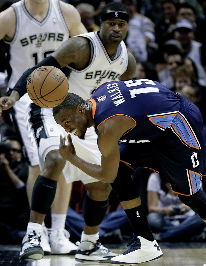 Charlotte Bobcats' Kemba Walker (15) loses control of the ball against San Antonio Spurs' Stephen Jackson, left, during the first half of an NBA basketball game, Wednesday, Jan. 30, 2013, in San Antonio. Photo: Eric Gay, Associated Press / AP