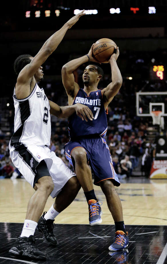 Charlotte Bobcats' Ramon Sessions (7) shoots over San Antonio Spurs' Kawhi Leonard (2) during the second half of an NBA basketball game, Wednesday, Jan. 30, 2013, in San Antonio. Photo: Eric Gay, Associated Press / AP