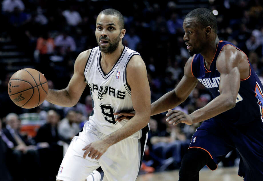 San Antonio Spurs' Tony Parker (9), of France, drives around Charlotte Bobcats' Kemba Walker, rigth, during the first half of an NBA e game, Wednesday, Jan. 30, 2013, in San Antonio. Photo: Eric Gay, Associated Press / AP