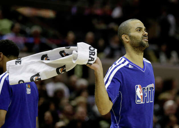San Antonio Spurs' Tony Parker, of France, waves a towel during the second half of an NBA basketball game against the Charlotte , Wednesday, Jan. 30, 2013, in San Antonio. (AP Photo/Eric Gay) Photo: Eric Gay, Associated Press / AP