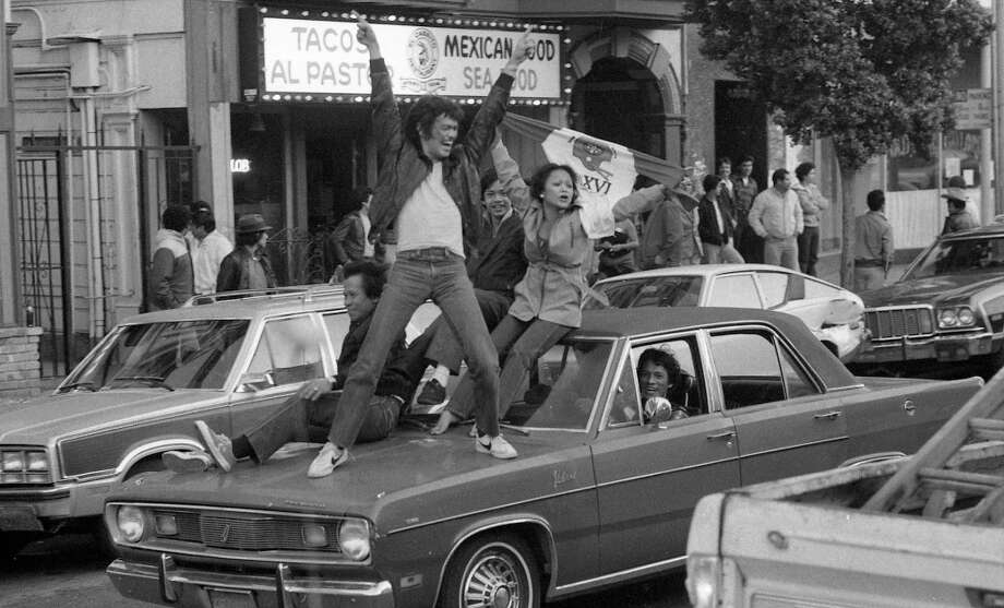 MISSION DISTRICT: While there was no visible violence or vandalism, it did look like someone was filming a Leonard Bernstein musical on the streets of the Mission after the Super Bowl XVI victory. Autos in 1982 were better equipped to handle people standing on the hoods. Photo: John O'Hara, The Chronicle / ONLINE_YES
