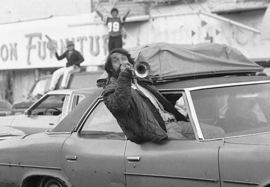 MISSION DISTRICT: Herb Alpert's brother celebrates the 49ers win. From the Jan. 25, 1982 Chronicle article: *In the Mission District, a seemingly endless stream of slow-moving cars choked traffic on Mission Street from 15th Street on the north to Army Street on the south.* Photo: John O'Hara, The Chronicle / ONLINE_YES
