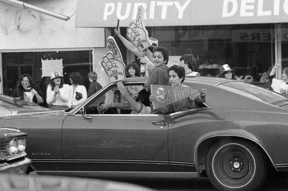 MISSION DISTRICT: This may look like bad parenting, but in 1982 we all rode while hanging on the outside of cars. We took entire driving tests in the early 1980s with with arms hanging out the window waving a foam finger. In other news, I had that pennant. Photo: John O'Hara, The Chronicle / ONLINE_YES