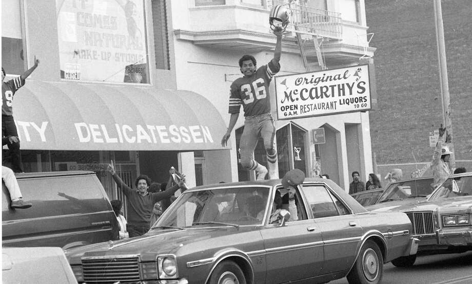 MISSION DISTRICT: Another angle of the Paul Hofer fan Chrysler Cordoba car surfer. From the Jan. 25, 1982 Chronicle article: *One maniacal fan dressed in a 49er uniform and helmet stood atop his moving vehicle, thrusting his fists at every passing car.* Photo: John O'Hara, The Chronicle / ONLINE_YES