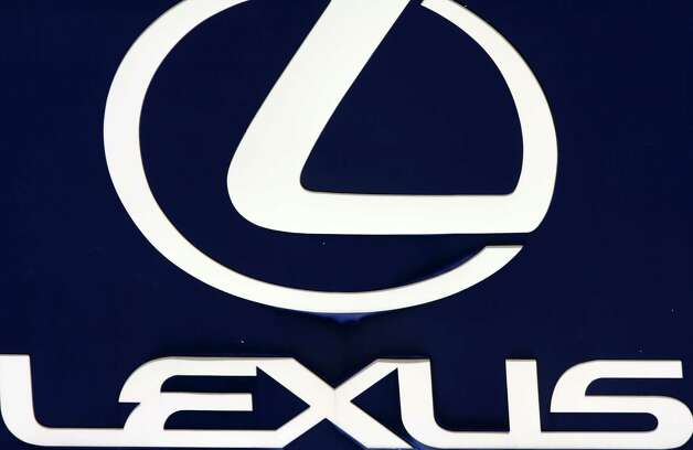 FILE - In this April 13, 2010 file photo, the Lexus logo is seen on a sign at a dealership in Portland, Maine. Toyota is recalling 907,000 vehicles, mostly Corolla models, around the world for faulty air bags and another 385,000 Lexus IS luxury cars for defective wipers. Toyota Motor Corp. spokesman Naoto Fuse said Wednesday, Jan. 30, 2013, there have been no accidents or injuries related to either of those defects, but the Japanese automaker received 46 reports of problems involving the air bags from North America, and one from Japan. There were 25 reports of problems related to the windshield wipers. (AP Photo/Pat Wellenbach, File) Photo: Pat Wellenbach