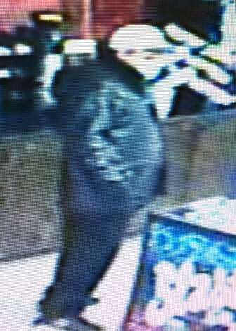 Police are asking the public for help identifying a robber who held up a Southwest Side convenience store last week wearing black gloves and a blue surgical mask. Photo: Courtesy