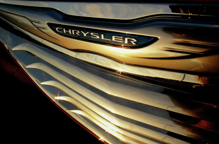 FILE - In this photo taken July 24, 2011, a setting sun is reflected in the front grill of a new Chrysler for sale at the Chrysler dealership in Springfield, Ill. Chrysler says its profit jumped to $1.7 billion in 2012 as sales rose 18 percent.  Chrysler's profit was nine times higher than the $183 million recorded in 2011. (AP Photo/Seth Perlman, File) Photo: Seth Perlman