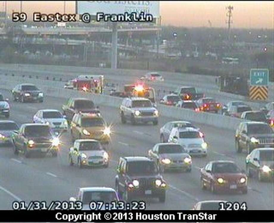 A two-vehicle wreck snarled traffic on the northbound Eastex Freeeway near downtown during rush hour Thursday morning. Photo: Houston Transtar