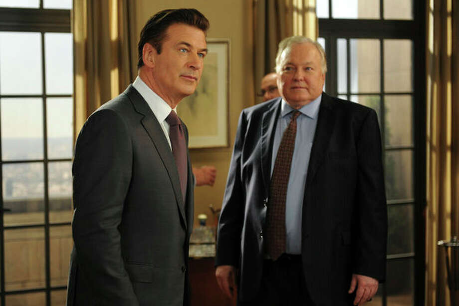 30 ROCK -- Part 1: Hogcock! Part 2: Last Lunch Episode 712/713 -- Pictured: (l-r) Alec Baldwin as Jack Donaghy, Jim Downey as Downey -- Photo: NBC, Ali Goldstein/NBC / 2012 NBCUnivesal Media, LLC.