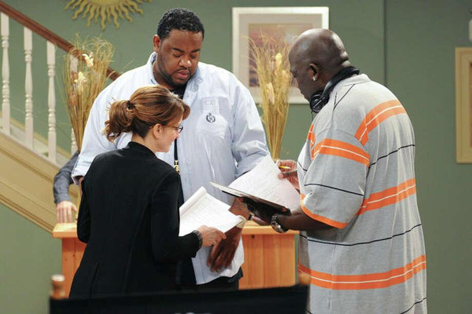 30 ROCK -- Part 1: Hogcock! Part 2: Last Lunch Episode 712/713 -- Pictured: (l-r) Tina Fey as Liz Lemon, Grizz Chapman as Grizz, Kevin Brown as Dotcom -- Photo: NBC, Ali Goldstein/NBC / 2012 NBCUnivesal Media, LLC.