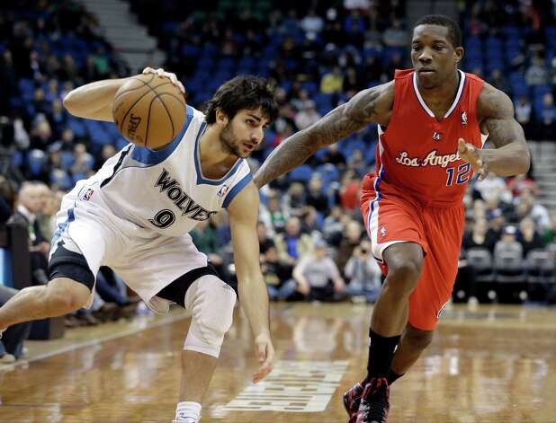 Minnesota Timberwolves' Ricky Rubio of Spain, left, maintains his balance as he drives past Los Angeles Clippers' Eric Bledsoe in the first half of an NBA basketball game Wednesday, Jan. 30, 2013 in Minneapolis. (AP Photo/Jim Mone) Photo: Jim Mone, STF / AP