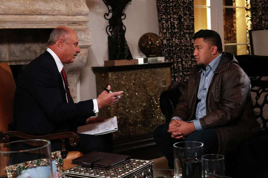 "In this Jan. 24, 2013, photo provided by CBS Television Distribution/Peteski Productions, talk show host Dr. Phil McGraw, left, interviews Ronaiah Tuiasosopo during taping for the ""Dr. Phil Show"" in Los Angeles.  The program, scheduled to air Thursday, Jan. 31, and Friday, Feb. 1, will show the first on-air interview of Tuiasosopo, the man who allegedly concocted the girlfriend hoax that ensnared Notre Dame football star Manti Te'o. Photo: CBS Television Distribution/Peteski Productions"