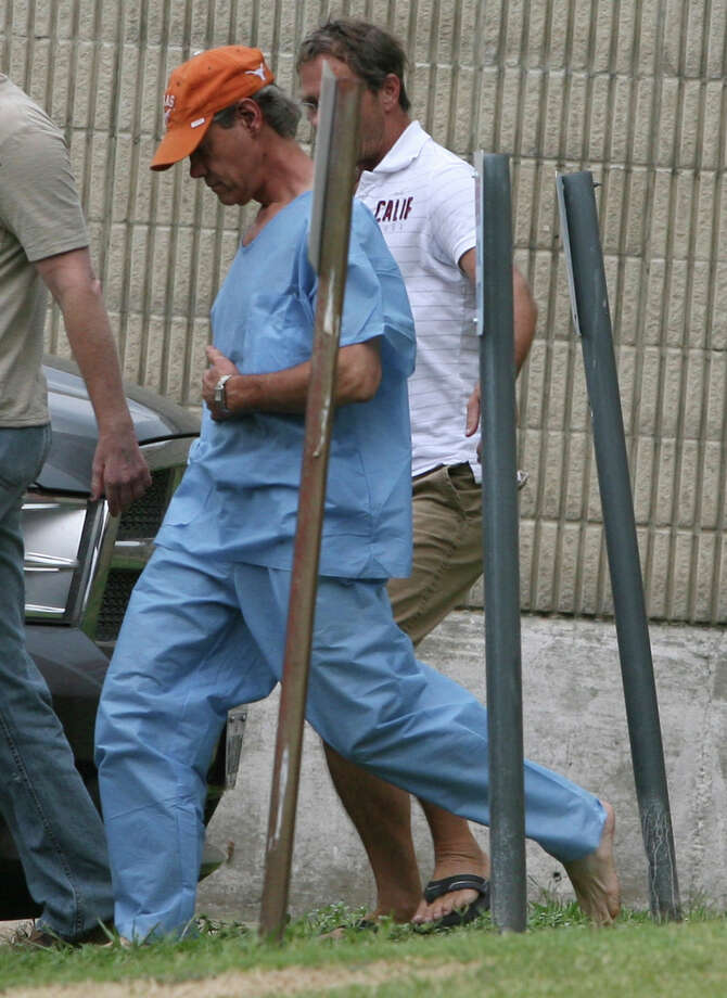 Randy Travis, center, wearing cap, exits the Grayson County jail with two unknown persons Wednesday Aug. 8, 2012, in Sherman, Texas, after being arraigned on charges of driving while intoxicated and retaliation. (AP Photo/The Herald Democrat, Chris Jennings) TV OUT; MAGS OUT; TV AND MAGAZINE CALL FOR RATES TERMS;MANDATORY CREDIT Photo: Chris Jennings, Associated Press / The Herald Democrat