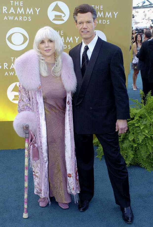 "Randy Travis, who is nominated for best male country vocal performance for ""Three Wooden Crosses"", arrives with his wife Elizabeth at the 46th Annual Grammy Awards, Sunday, Feb. 8, 2004, in Los Angeles. Photo: MARK J. TERRILL, AP / AP"